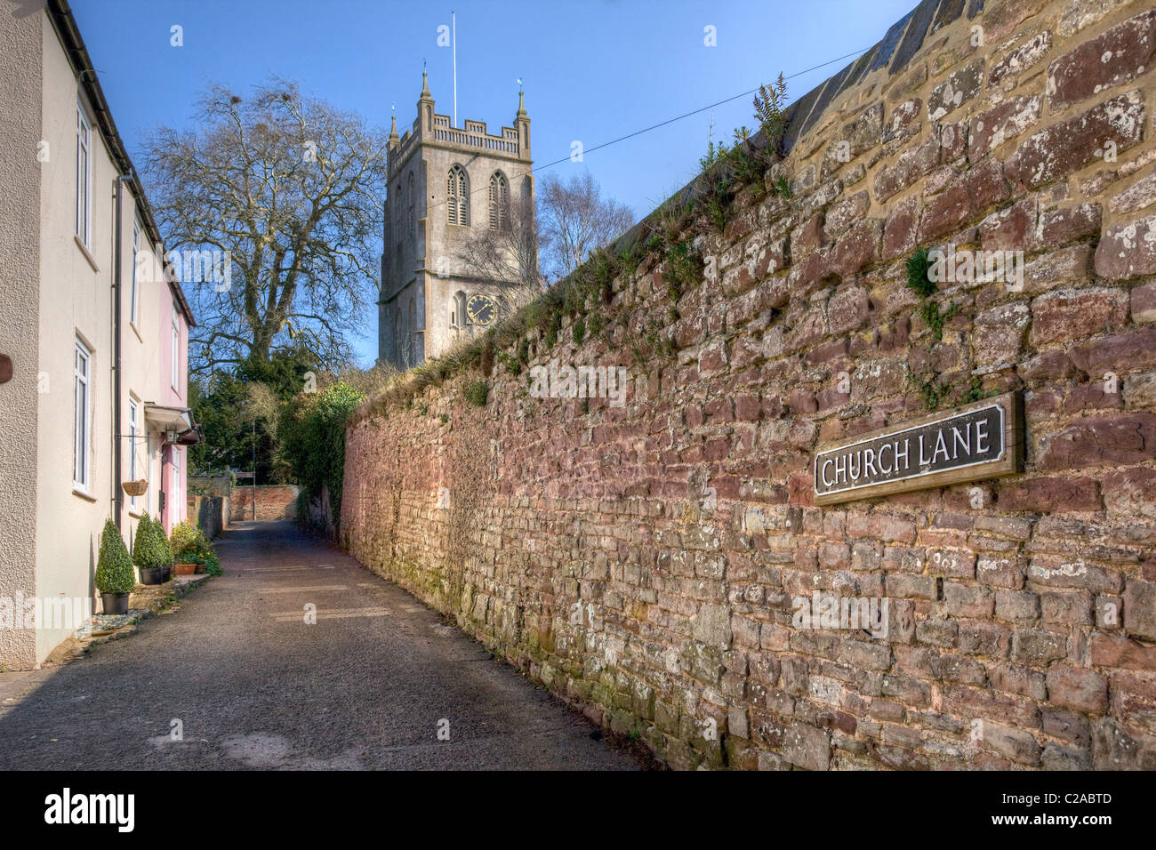 Church lane leading to St Mary the Virgin church Berkeley in Gloucestershire which has detached tower - Stock Image