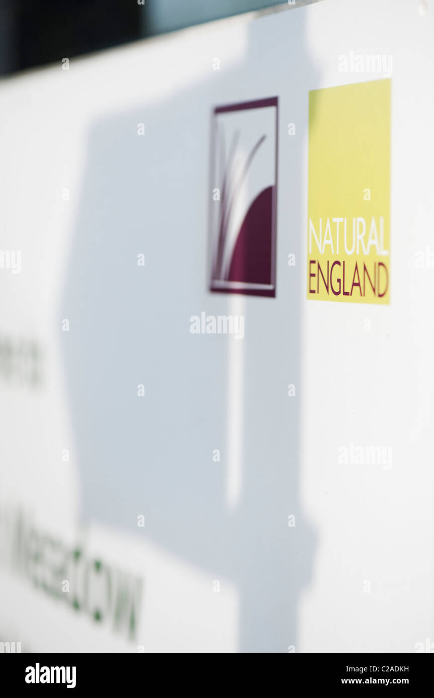 Natural England signpost with directional signpost shadow - Stock Image