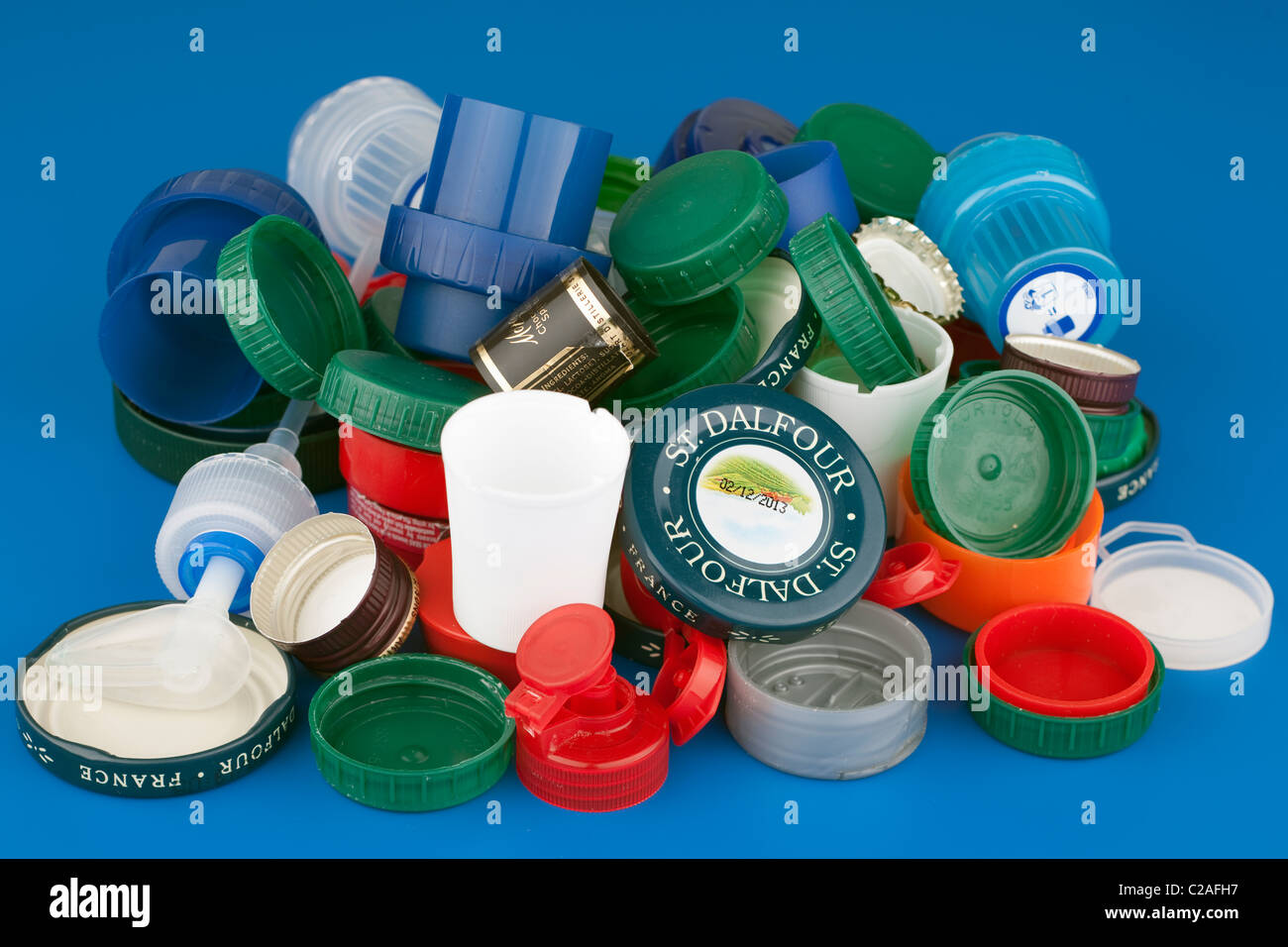 Pile of mixed product bottle and jar tops - Stock Image