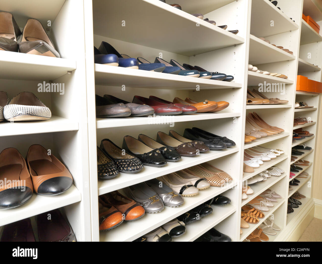 Storage designed and photographed by Tim Wood for over two hundred and fifty pairs of top brand shoes in a walk - Stock Image