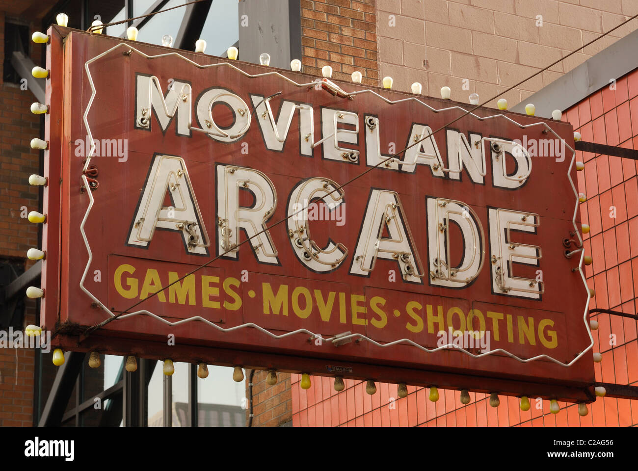 Neon sign advertising arcade games and movies for an arcade store on Granville Street Vancouver - Stock Image