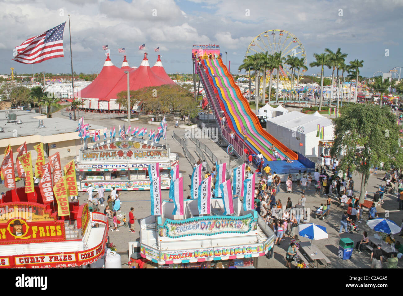 Elevated view ethnic mix people giant slide at Miami Dade County Fair Miami Florida - Stock Image