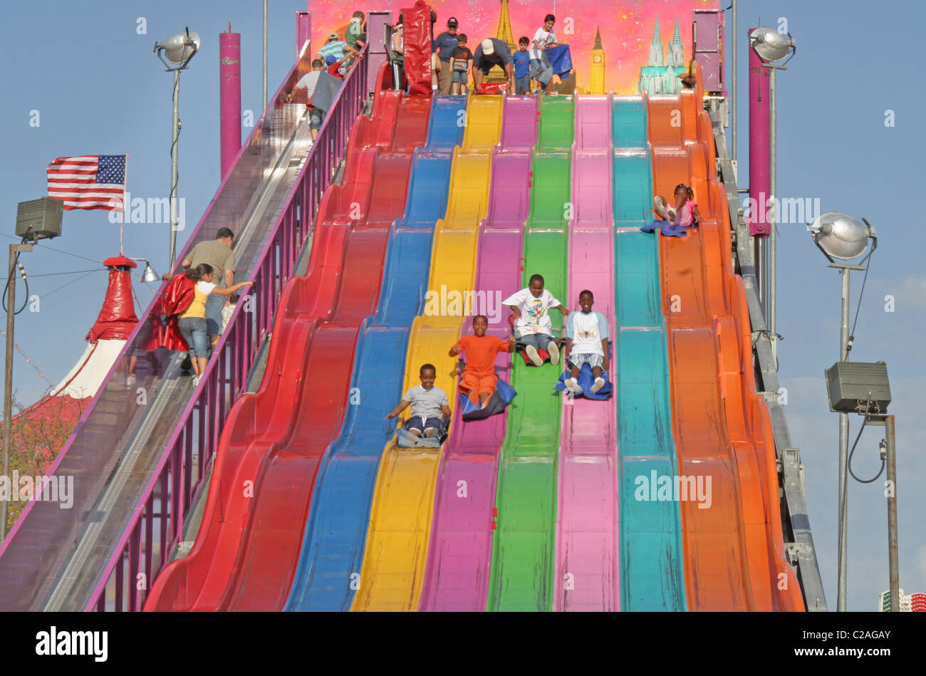 Ethnic Kids Down Giant Slide At Miami Dade County Fair