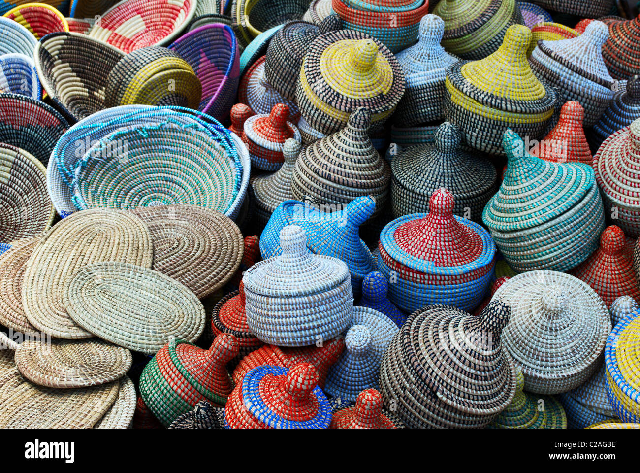 Group of multicolored woven baskets (selective focus the ones at the bottom of the image) - Stock Image