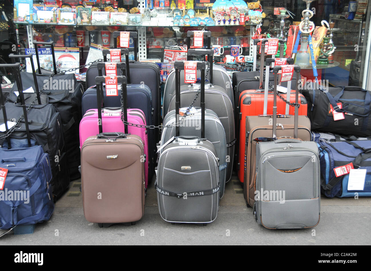 Suitcases luggage shop travel cases display sale on sale bargains arranged cheap - Stock Image