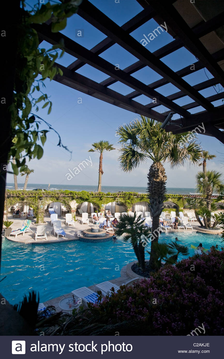 An enclosed veranda over looking the pool at historic Hotel Galvez. - Stock Image