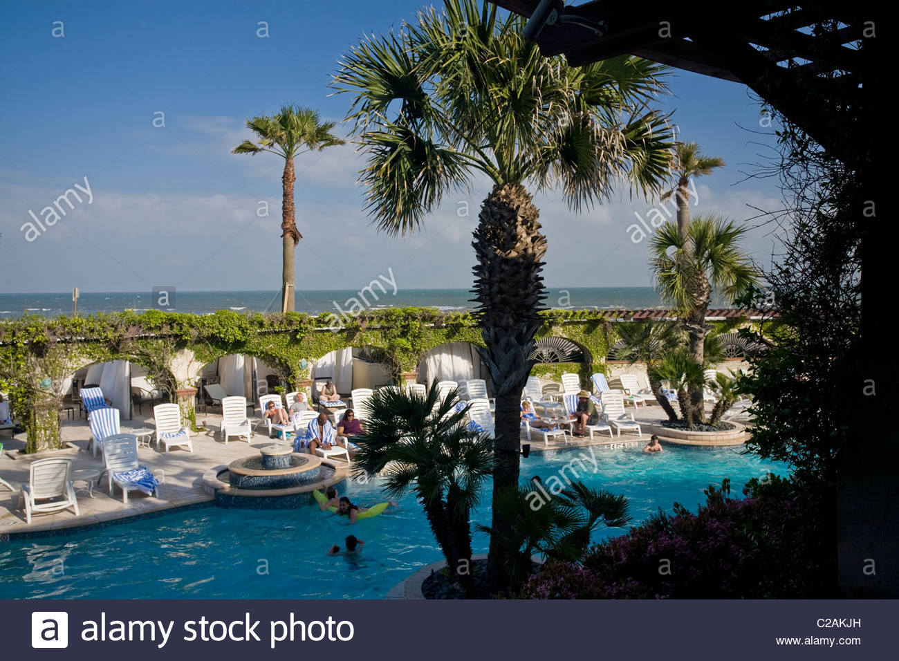 A view of the pool at historic Hotel Galvez from an enclosed veranda. - Stock Image