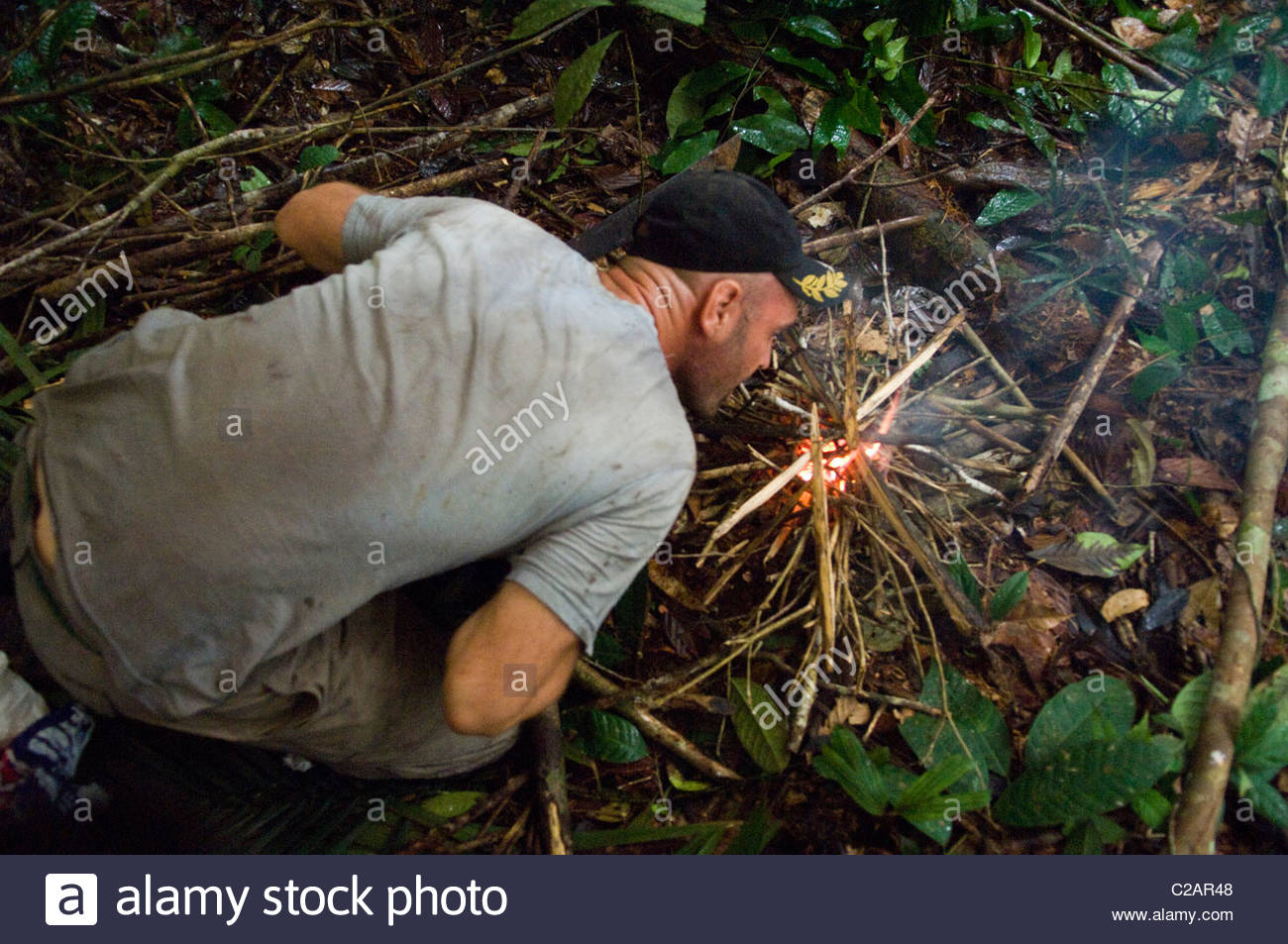 Ed Stafford starts a fire during his 859-day Amazon Jungle walk. - Stock Image