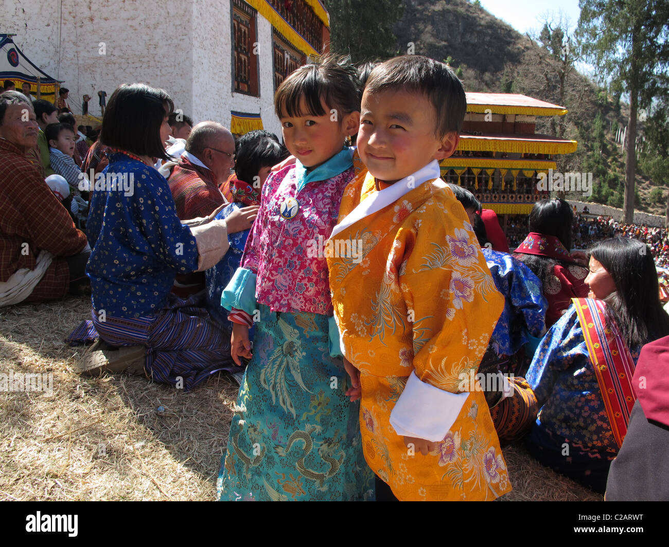 Happy children in colorful dresses during the Paro festival, West Bhutan - Stock Image