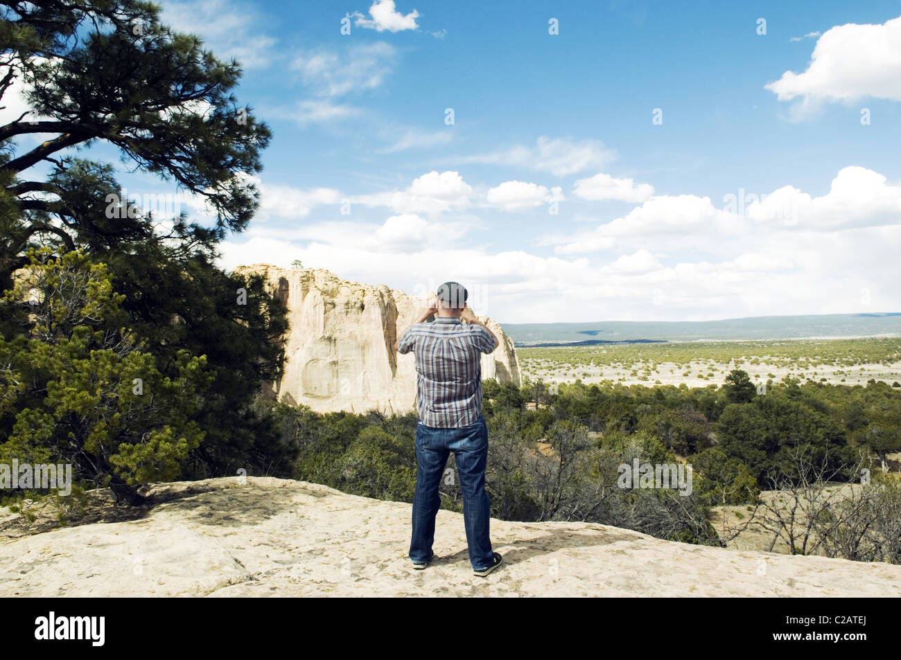 Tourist photographing El Morro National Monument, New Mexico, USA - Stock Image