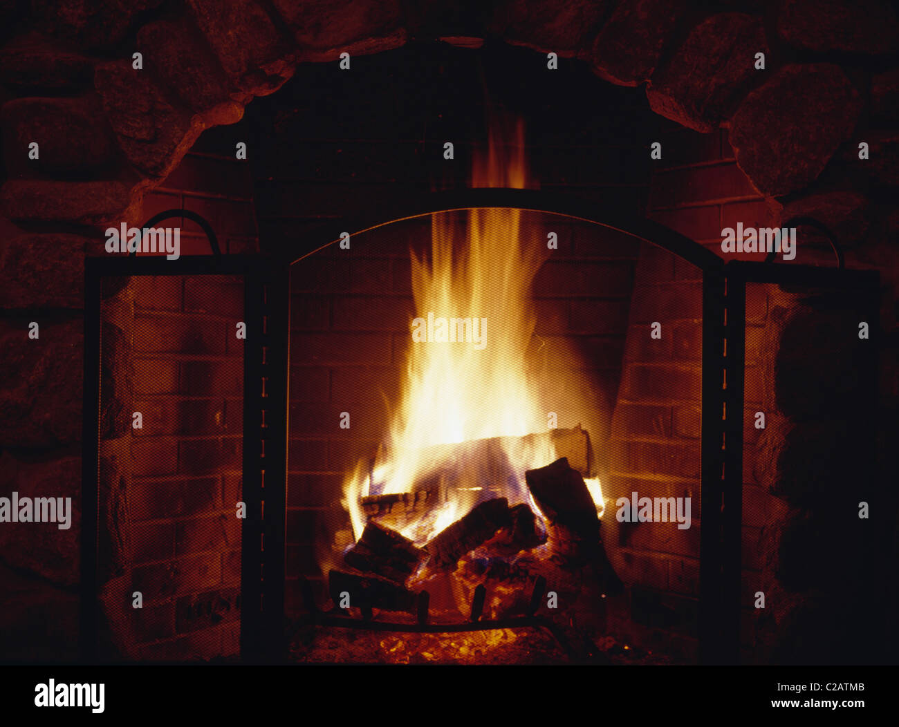 Fire burning in fireplace - Stock Image