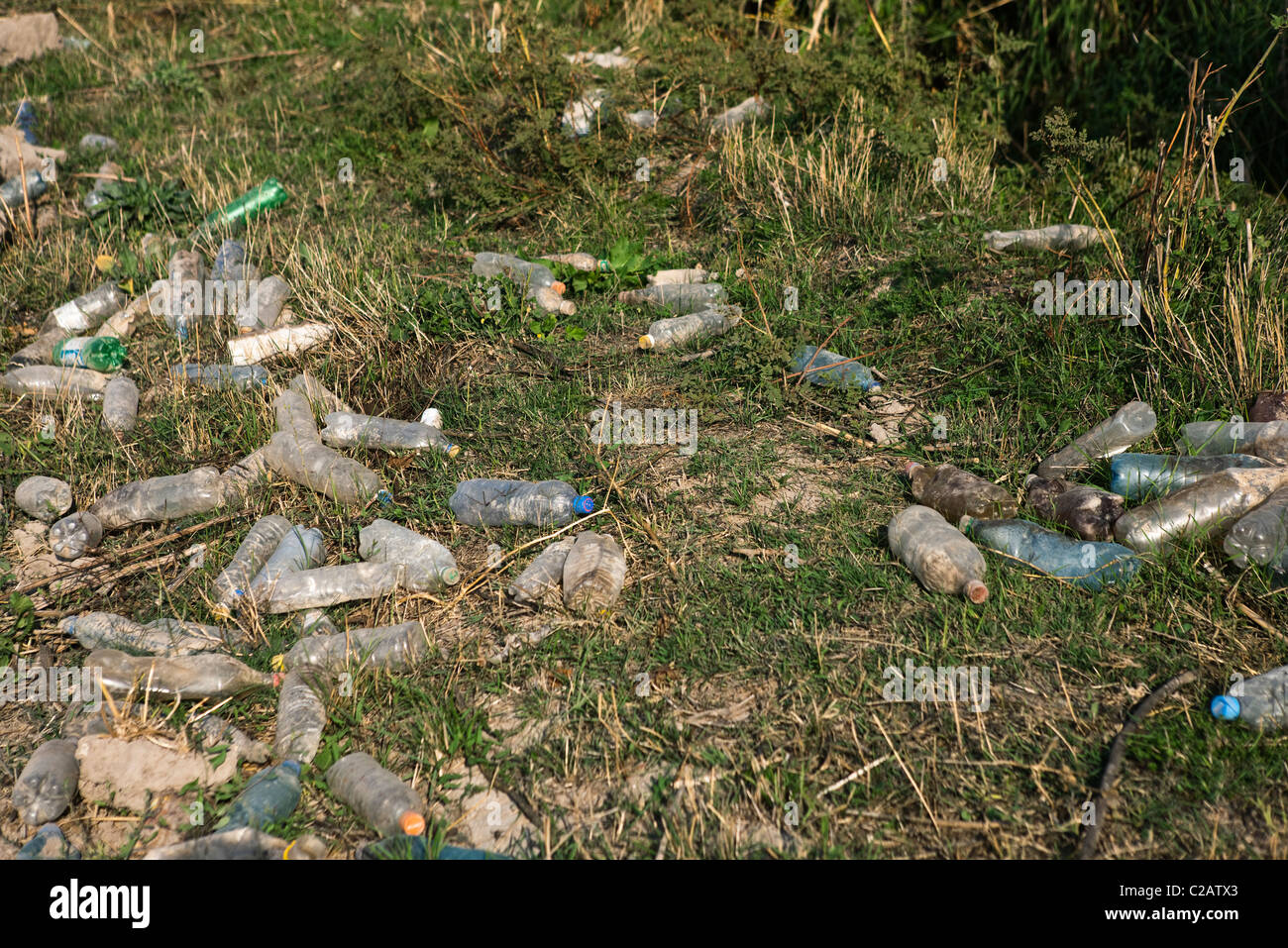 Discarded plastic bottles littering the ground Stock Photo
