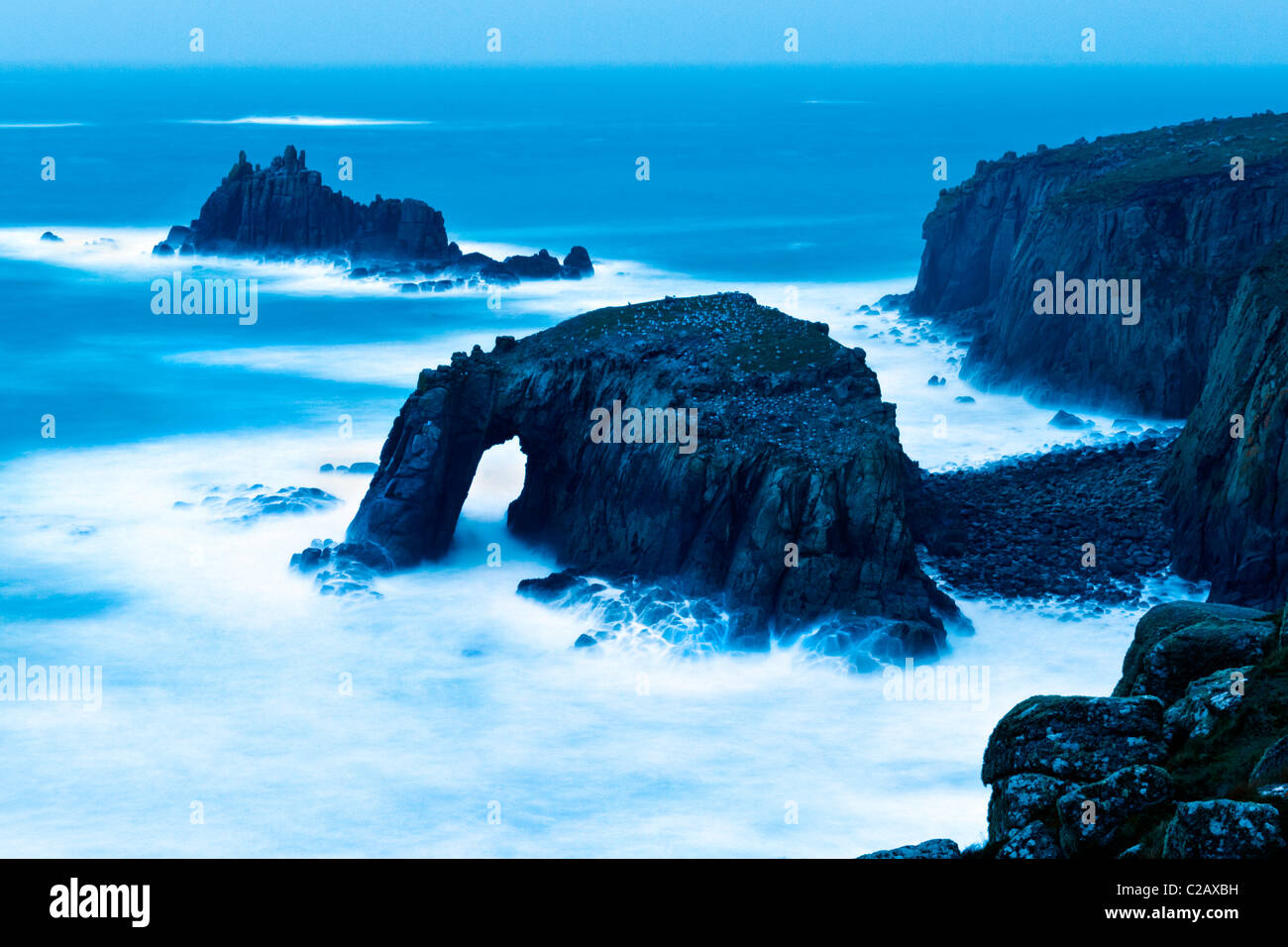 Rough seas at twilight at Land's End, Cornwall Stock Photo
