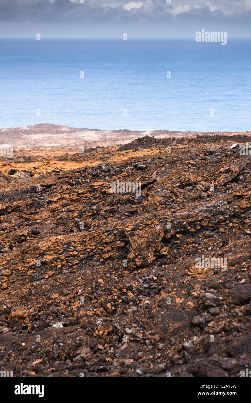Beach covered with volcanic rock, Reunion (French overseas department located in the Indian Ocean) - Stock Image