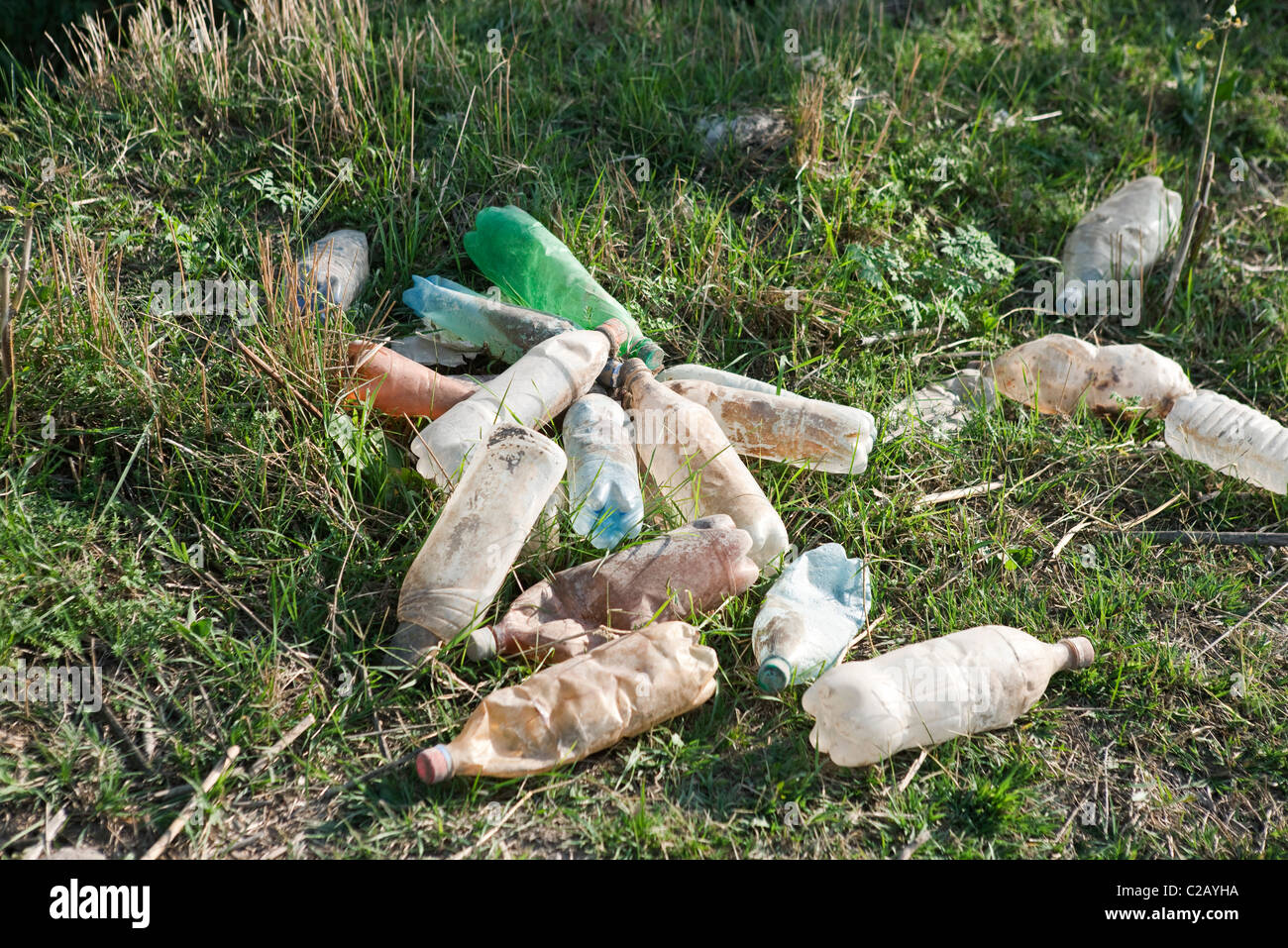 Discarded plastic bottles littering the ground - Stock Image