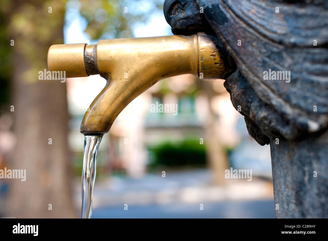 A public water fountain faucet - Stock Image