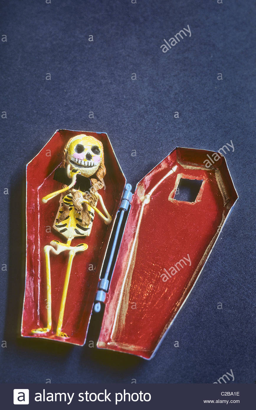 A folk art toy calavera and coffin sold for the Day of the Dead. - Stock Image