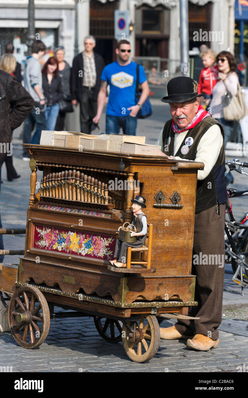 Old barrel organ player in the Grote Markt (Main Square), Antwerp, Belgium - Stock Image