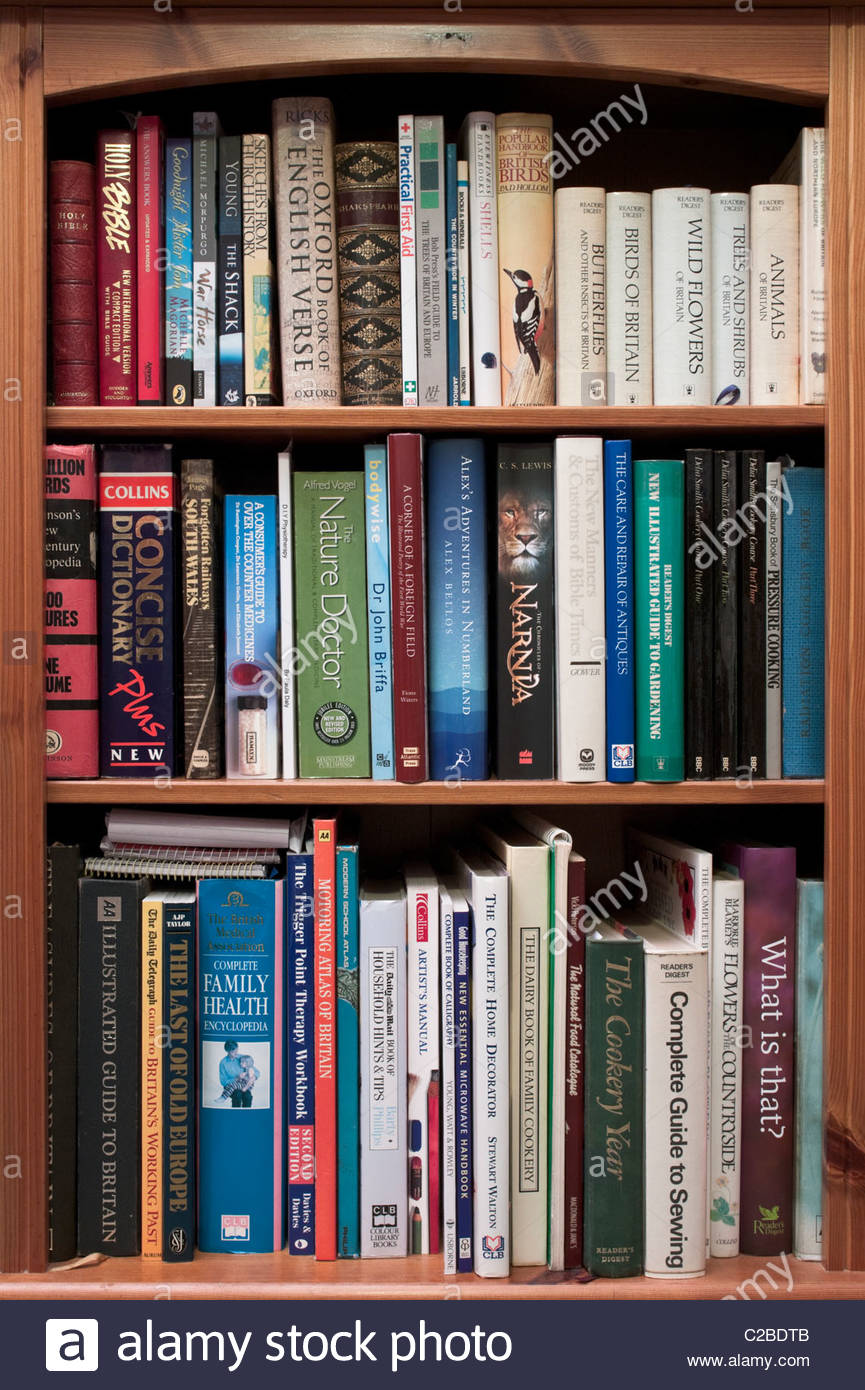 Bookcase with reference books - Stock Image