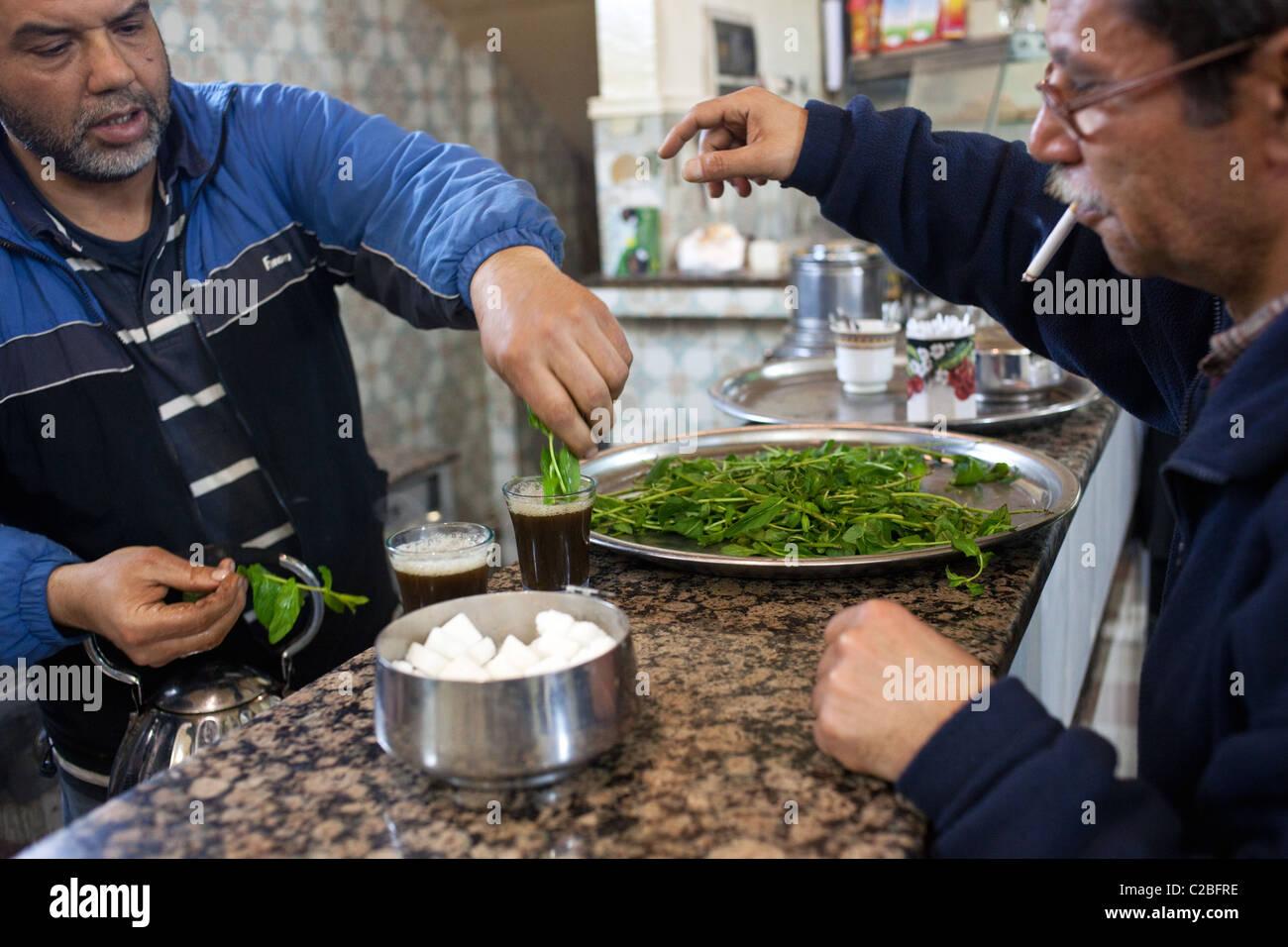 Men prepare mint tea a traditional coffeehouse in Sousse, Tunisia. Stock Photo