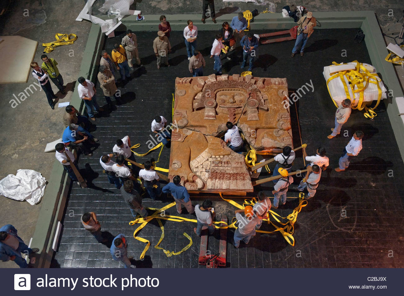 The Tlaltecuhtli Stone is moved from the excavation site to museum. - Stock Image