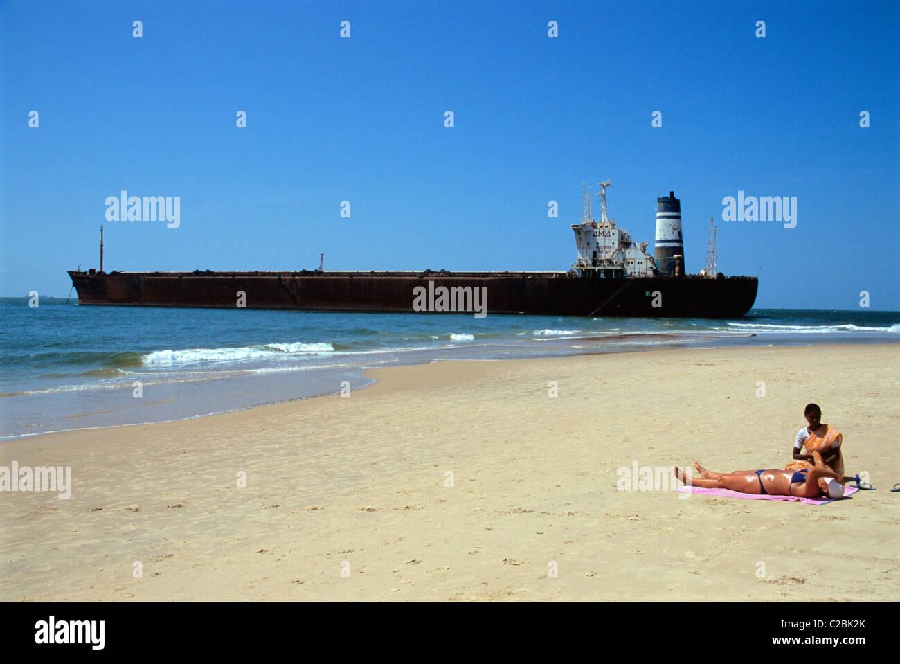 beach massage stranded oil tanker Candolim Goa India Stock