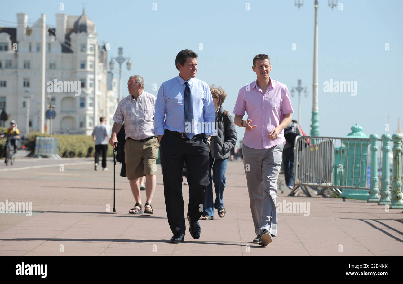 Former ahtletes Tim Hutchings (left) and Steve Cram walking along Brighton seafront prior to the 2011 marathon in - Stock Image