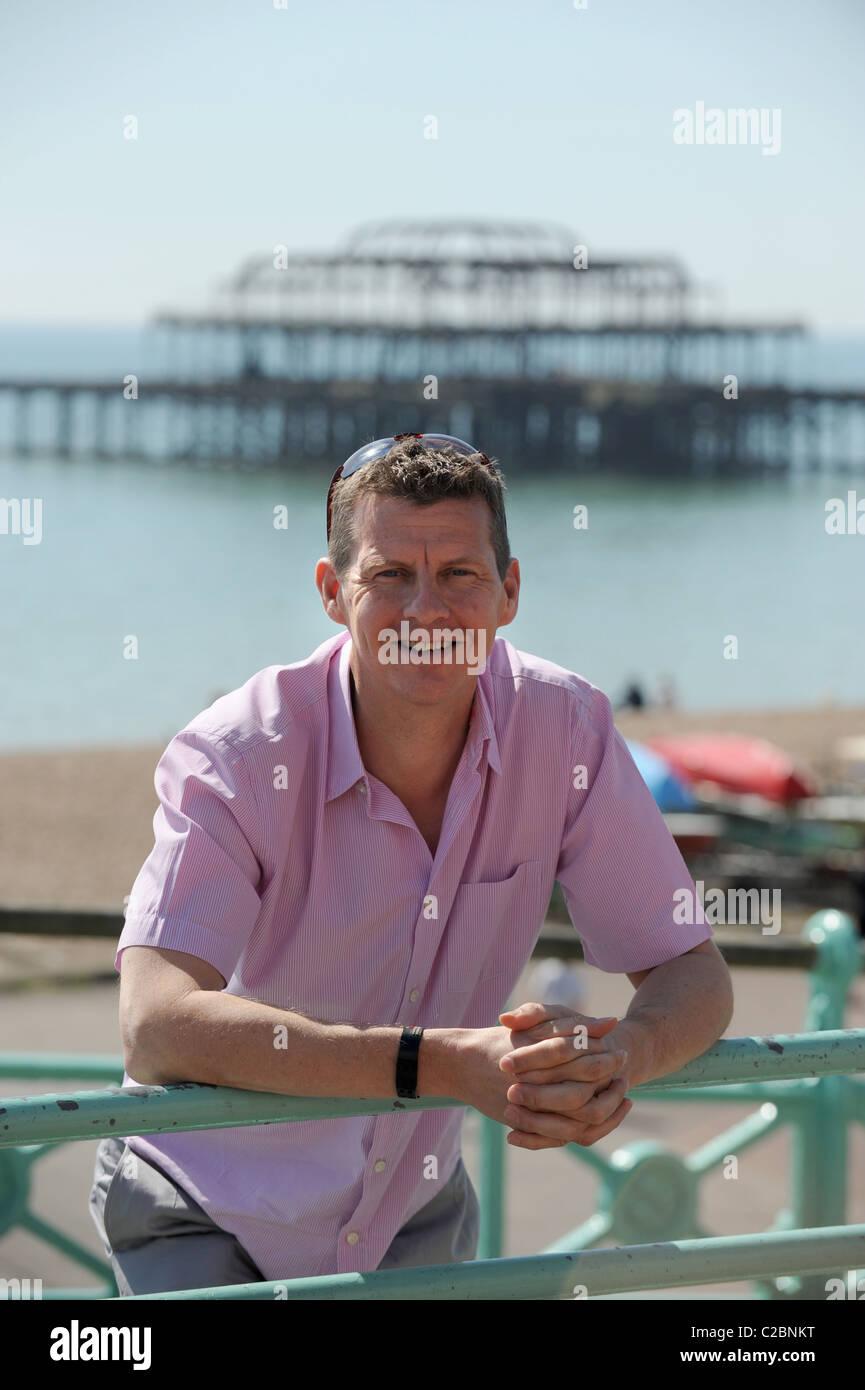 Former 1500m World Champion and record holder Steve Cram on Brighton seafront prior to this years Brighton Marathon - Stock Image