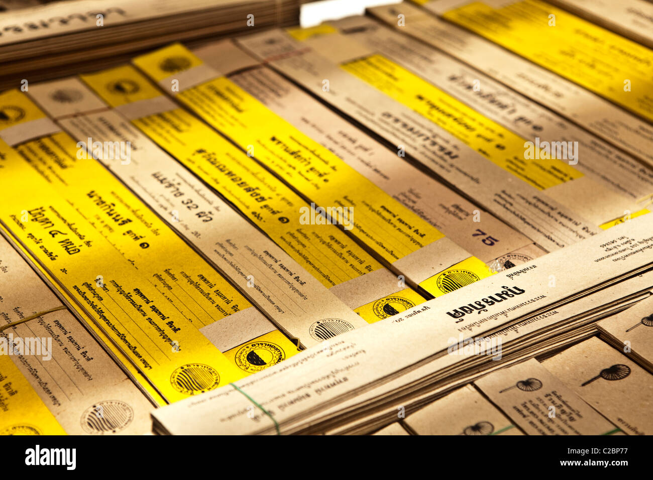 Buddhism canon(sacred book) sale in bookstore in Lampang, Thailand - Stock Image