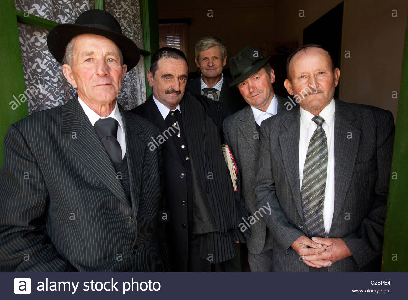 Members of the clergy, after Sunday mass in a small town of 900 people - Stock Image