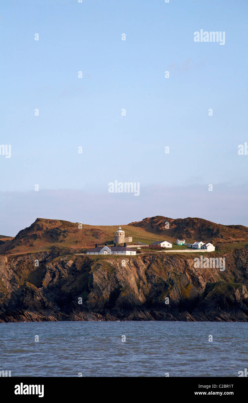Bull Point lighthouse, Morthoe viewed from the sea in March - Stock Image