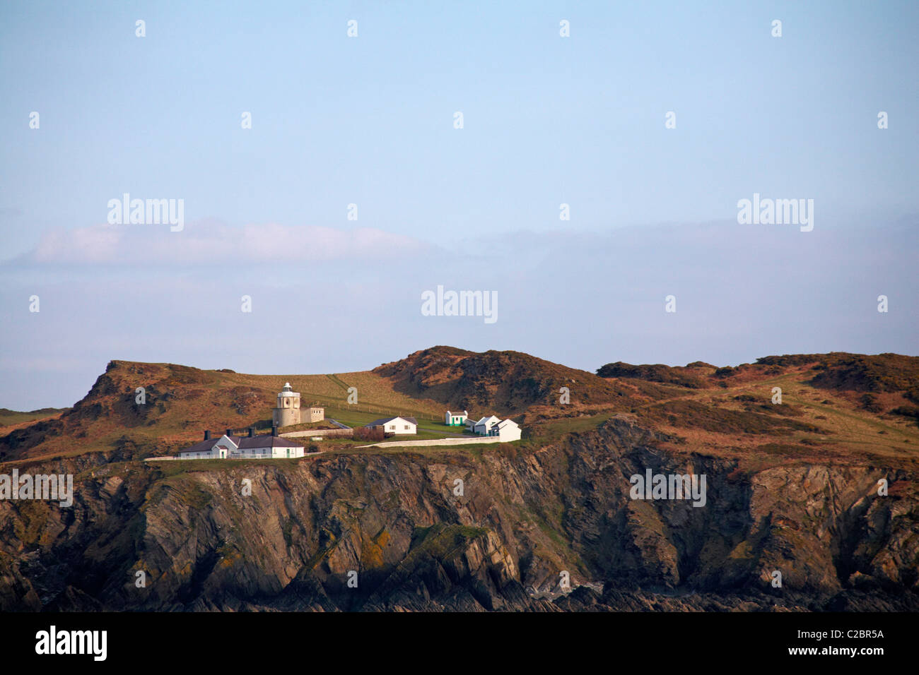 Bull Point lighthouse; Morthoe viewed from the sea in March - Stock Image