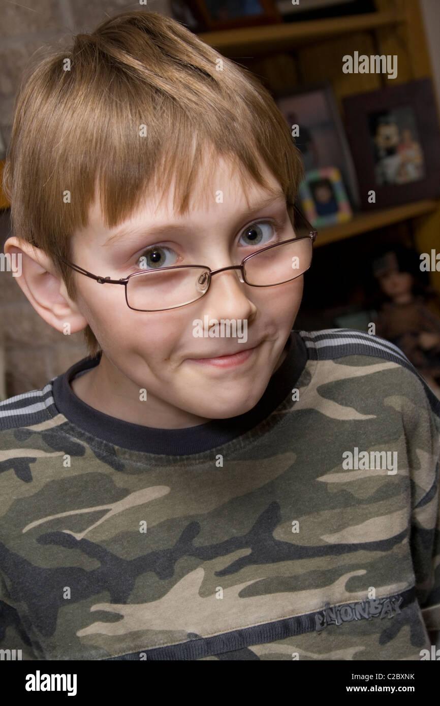 Portrait of boy age 11 with a Harry Potter look-alike. St Paul Minnesota MN USA - Stock Image