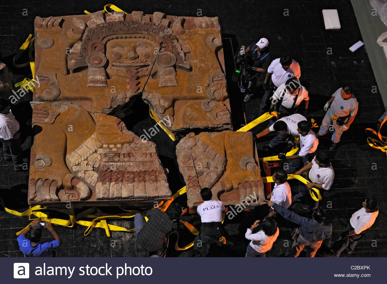 The Tlaltechutli Stone is moved from the excavation site to a museum. - Stock Image