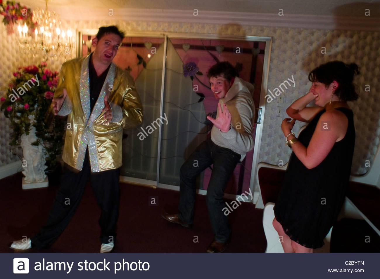 An Elvis impersonator serenades an Irish couple at a wedding chapel. - Stock Image