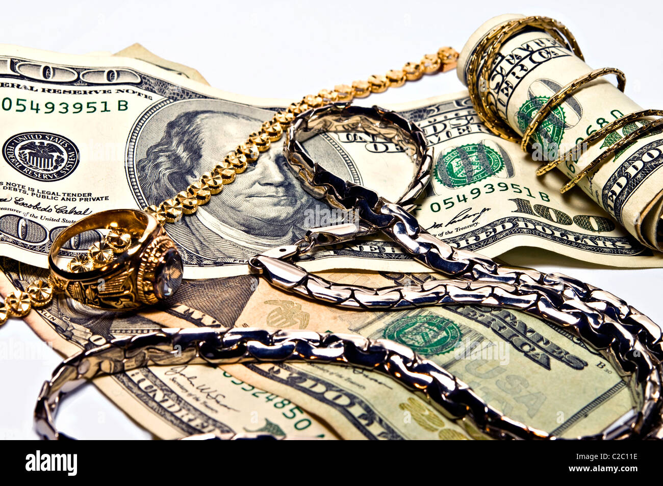 Money and jewelry as a concept for wealth, cash for gold and silver, or saving for retirement. - Stock Image