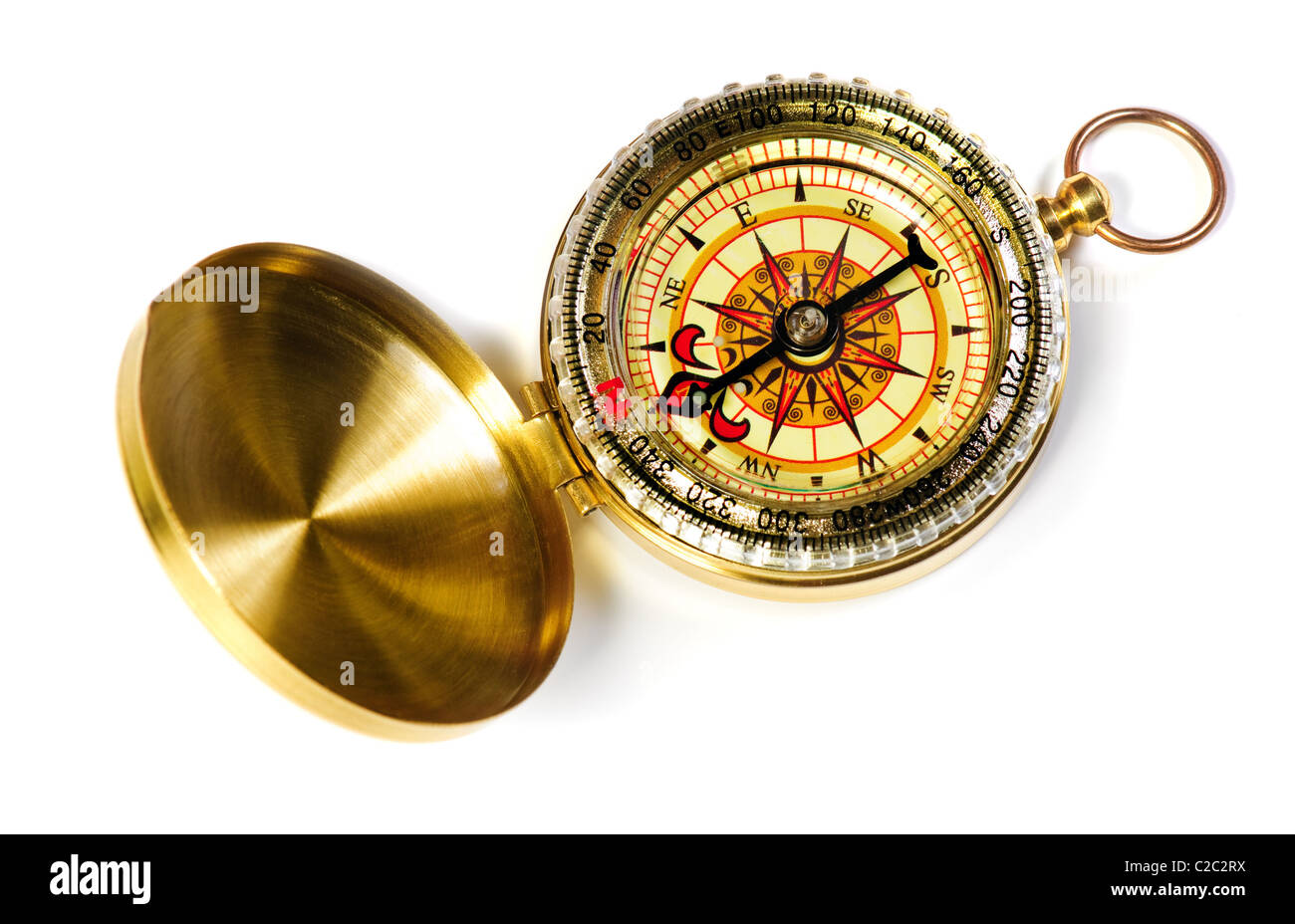 old-fashioned magnetic compass over white background - Stock Image