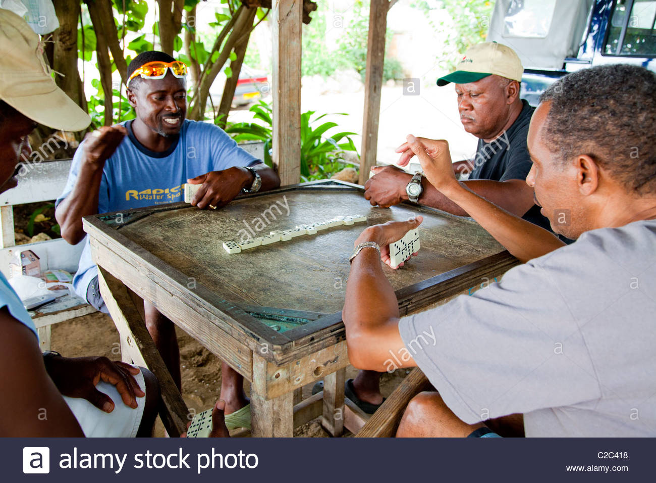 Bajan devotees of dominoes while away entire afternoons playing. - Stock Image