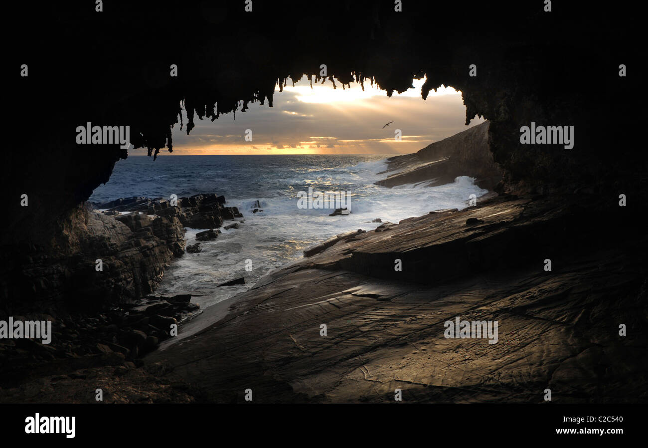 Rocky arch and seascape - Stock Image