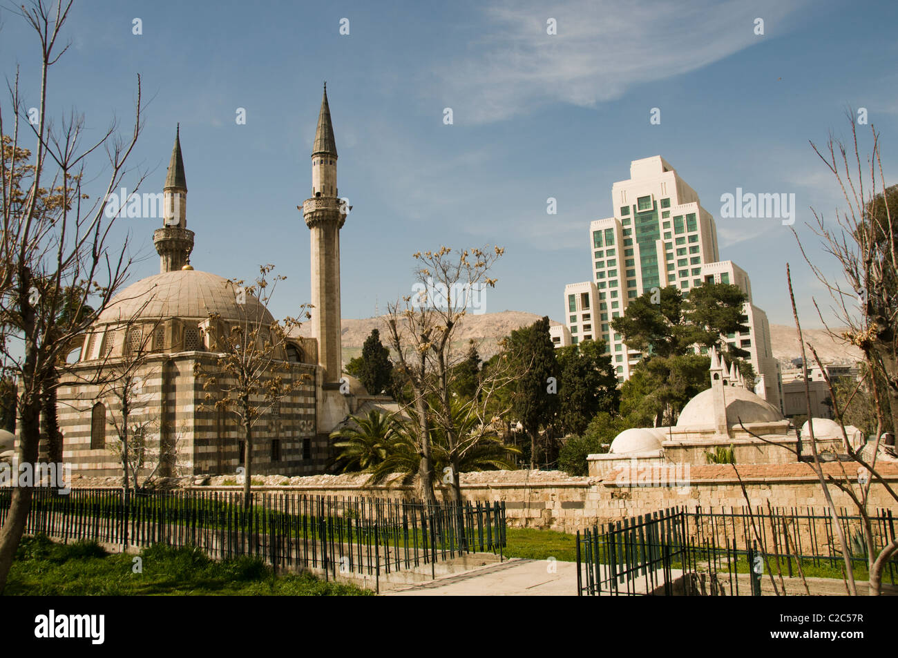 Four Seasons Hotel and Takiyya as Suleimaniyya a turkish style mosque Damascus Town City Syria Syrian - Stock Image