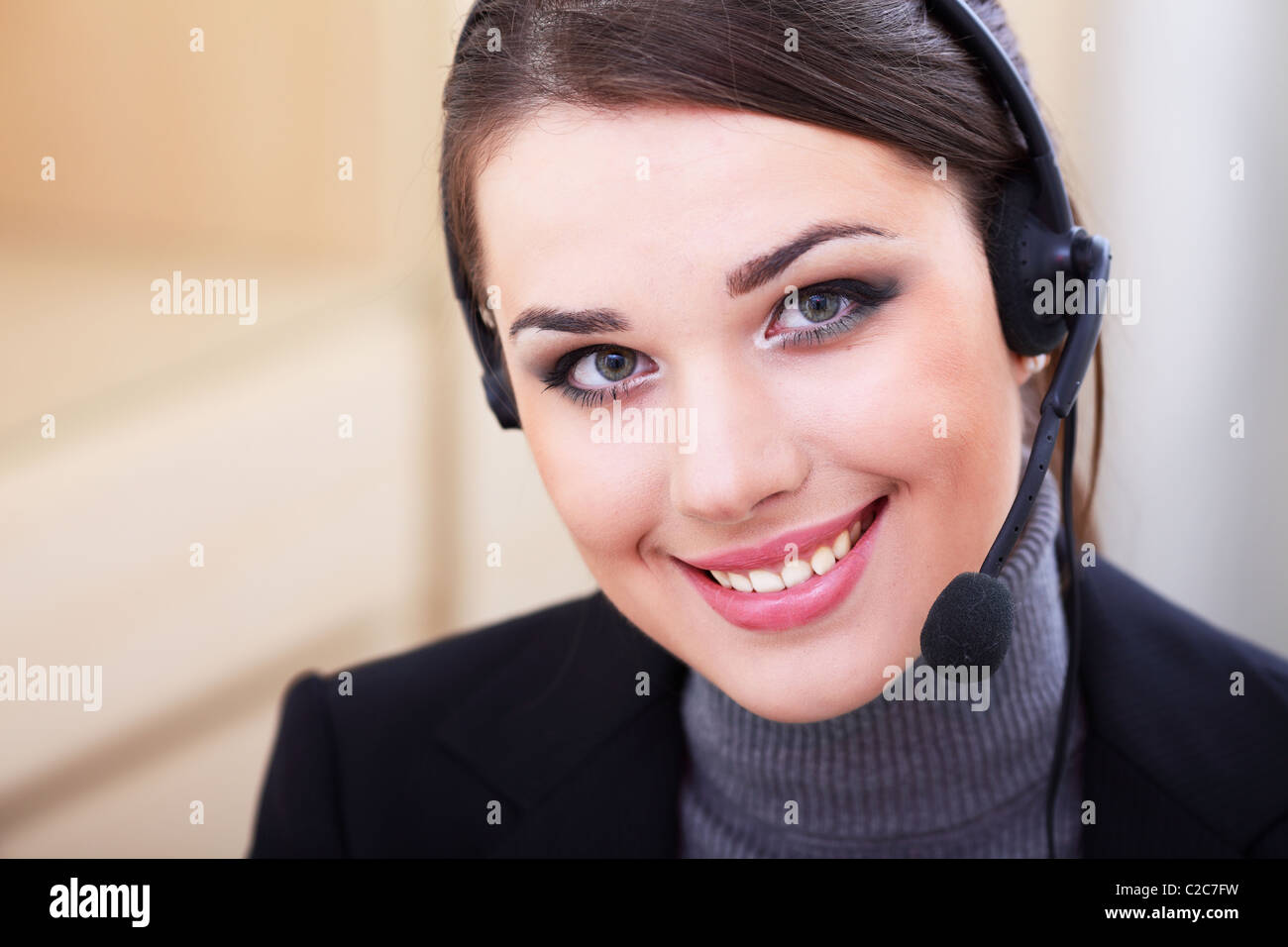 Beautiful call center operator with headset. - Stock Image