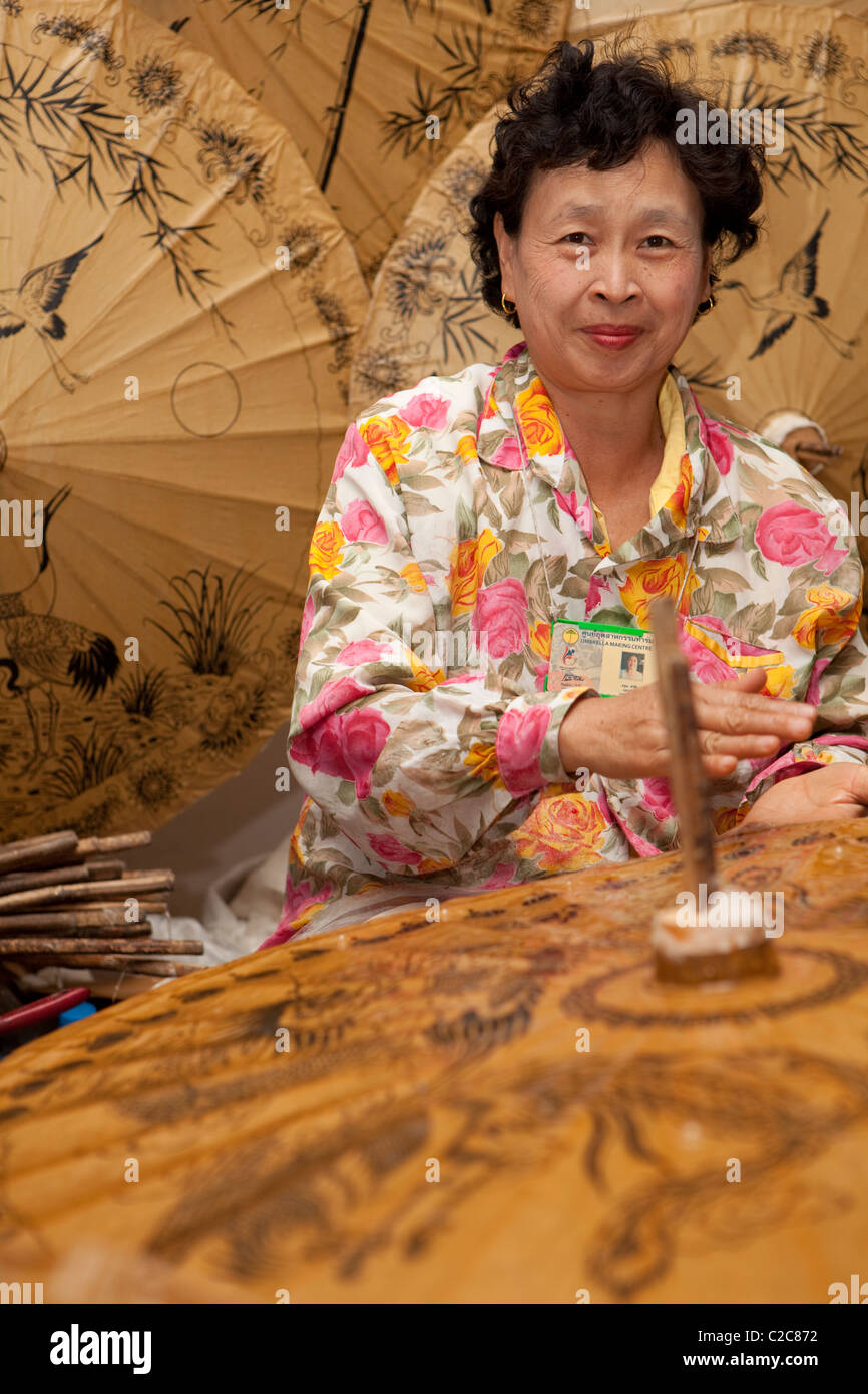 Woman umbrella artisan work finishing. Bo Sang, Sankamphaeng, Chiang Mai, Thailand - Stock Image