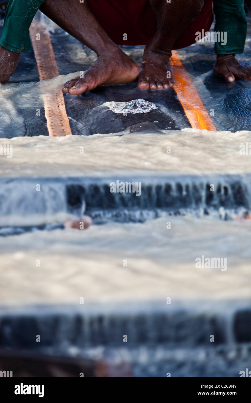 Amazon gold mining despescagem  removal of material collected in the sluice box by using mercury to amalgamate with - Stock Image