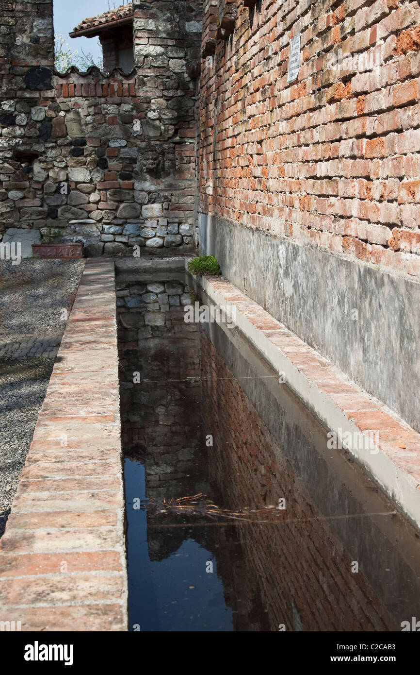 Trough in the medieval farming village - Stock Image