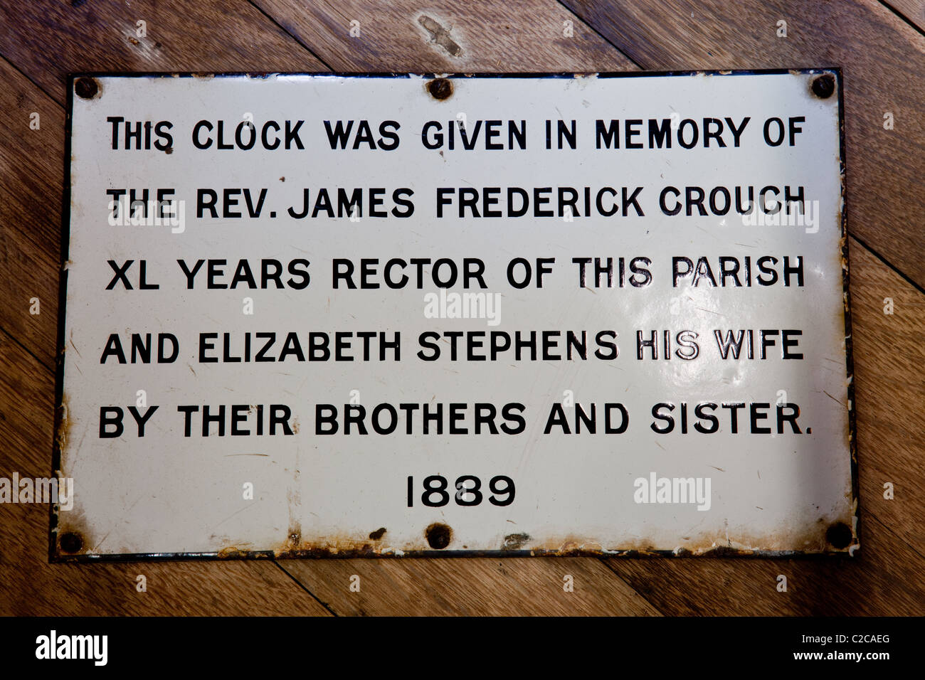 Plaque commemorating the clock inside the wooden clock tower of St Mary's Church, Pembridge, Herefordshire - Stock Image