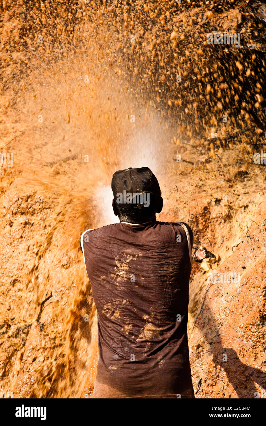 Hydraulic mining chupadeira system high-pressure jets of water to dislodge rock material Amazon gold mining Brazil - Stock Image