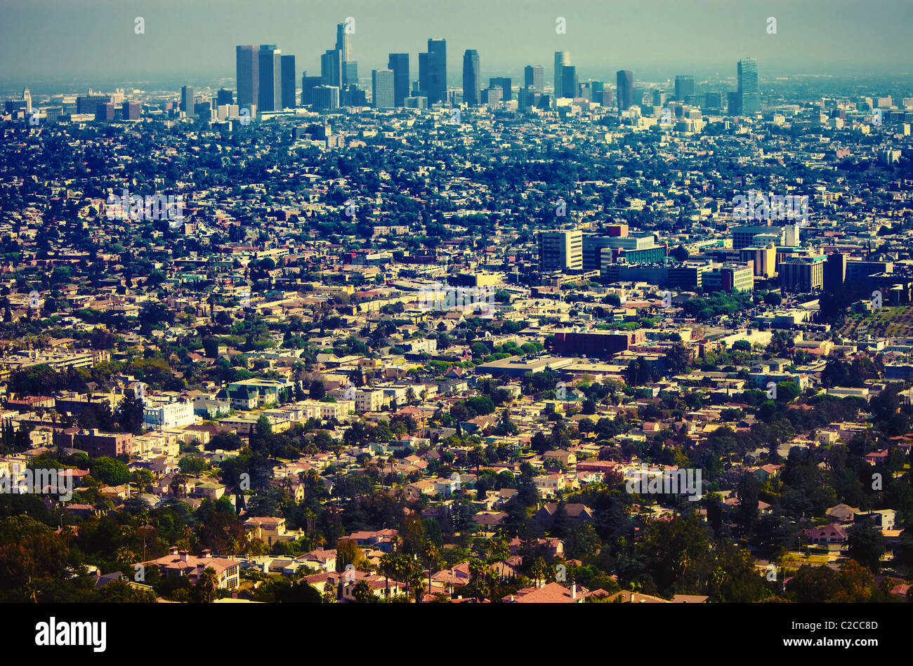 Los Angeles urban sprawl & downtown skyline as seen from a distance from scenic overlook at Griffith Observatory - Stock Image
