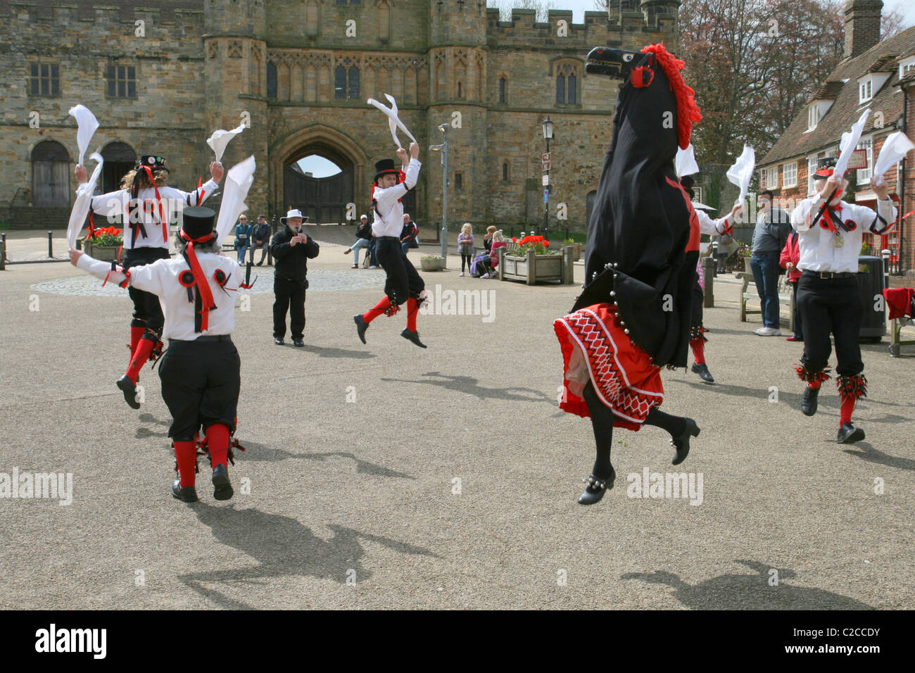 Headcorn Morris Men dancing in front of Battle Abbey on their Mayday tour, accompanied by Jason their Hooden Horse - Stock Image