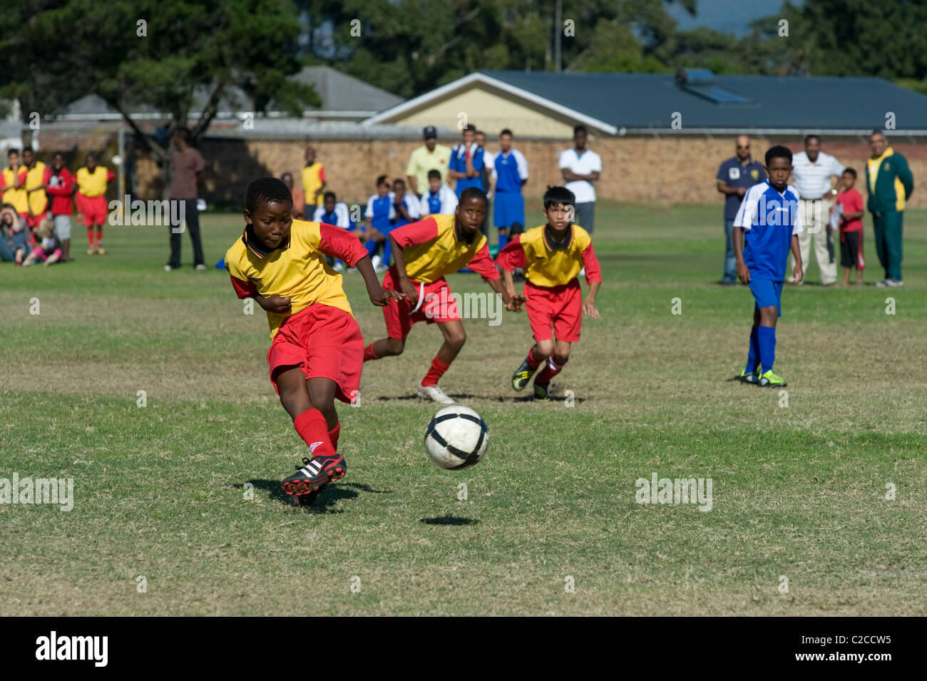 Boys under 13 team play a soccer match, Cape Town, South Africa - Stock Image