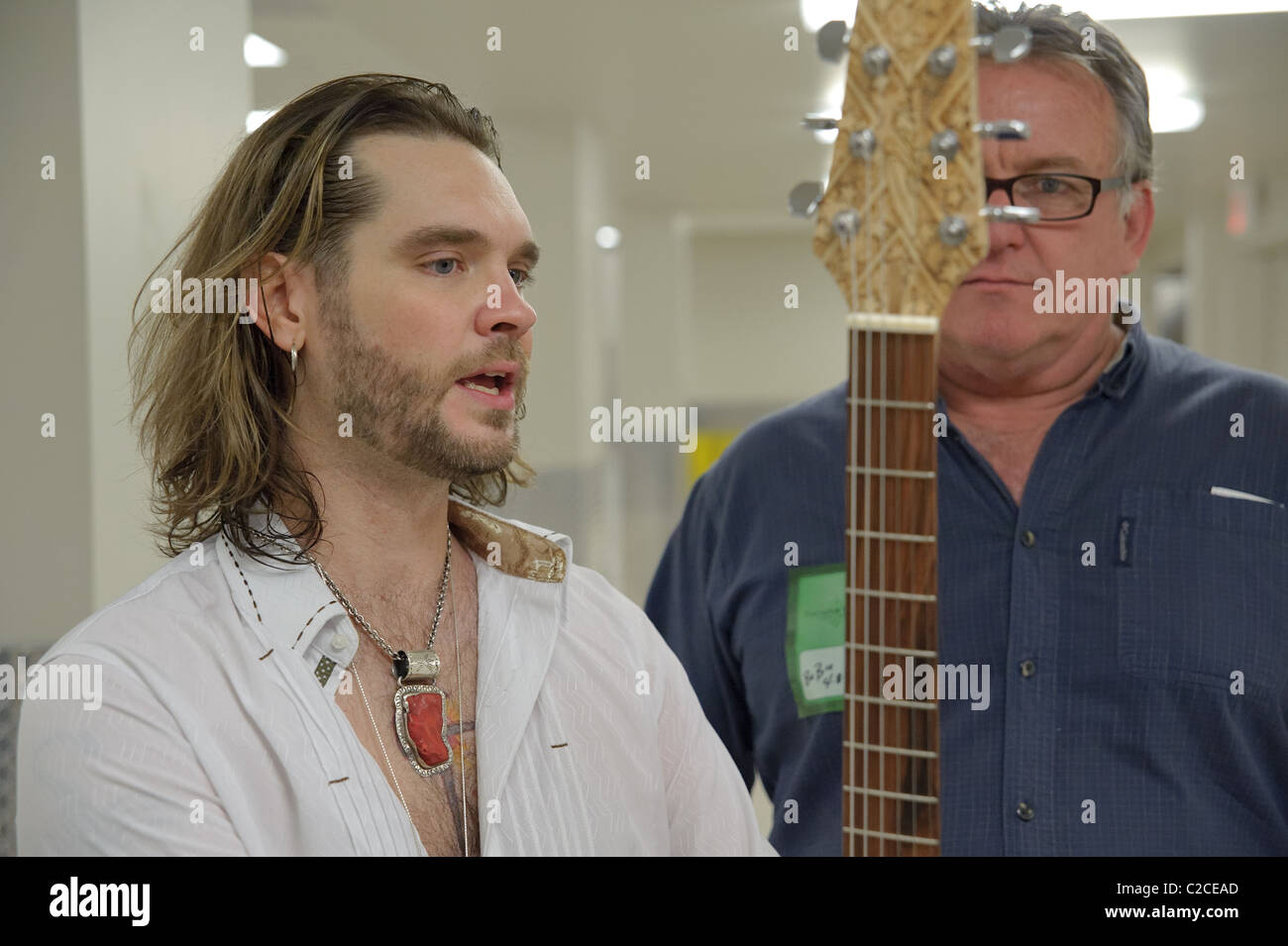 SACRAMENTO, CA - APRIL 8: Bo Bice talks about his new customer guitar. Pictured Bo Bice and Duane Calkins. Thunder - Stock Image